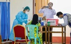 A medical worker receives AstraZeneca's COVISHIELD coronavirus disease (COVID-19) vaccine in Naypyitaw, Myanmar, after the country received 1.5 million doses of the vaccine manufactured by the Serum Institute of India, Jan 27, 2021. REUTERS