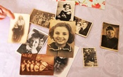 A collection of Holocaust survivor Leah Nebenzahl's family photographs are seen on a table during her interview with Reuters in Jerusalem January 25, 2021.  REUTERS