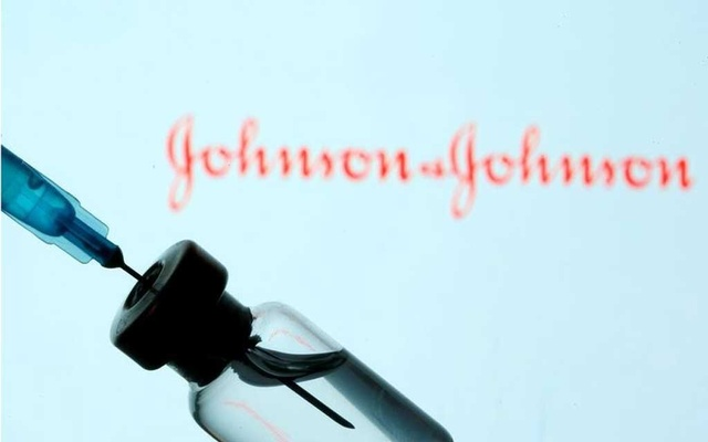 A vial and syringe are seen in front of a displayed Johnson & Johnson logo in this illustration taken January 11, 2021. Reuters