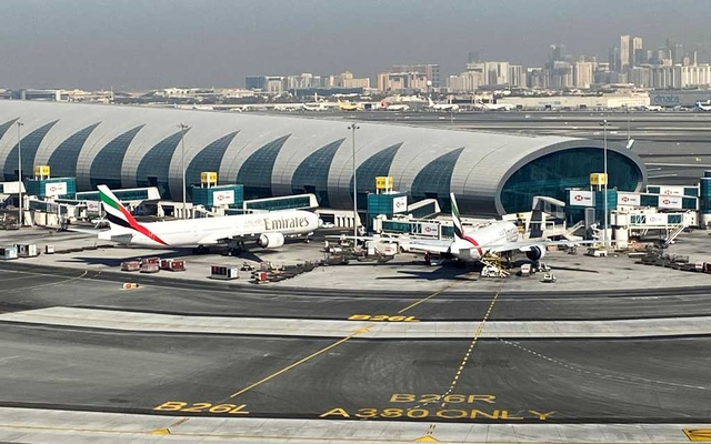Emirates planes are seen on the tarmac in a general view of Dubai International Airport in Dubai, United Arab Emirates January 13, 2021. Picture taken through a window. Reuters