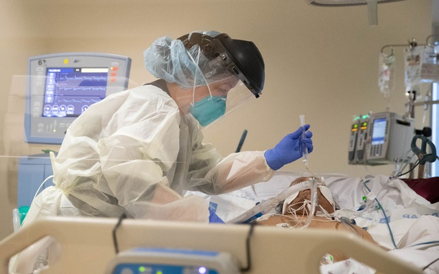 A respiratory therapist treats a coronavirus disease (COVID-19) patient, at LAC+USC Medical Center in Los Angeles, California, US, January 29, 2021. Reuters
