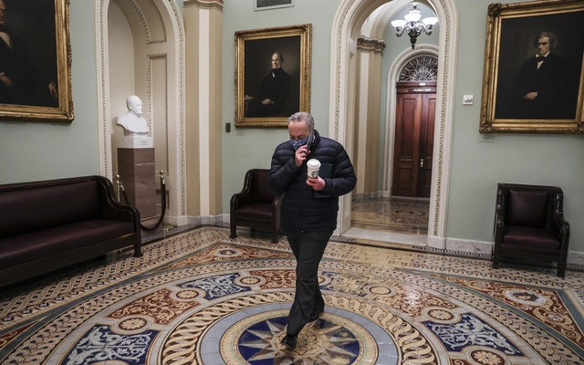 Senate Majority Leader Chuck Schumer walks to his office upon arrival at the Capitol in Washington, Jan 27, 2021 The New York Times