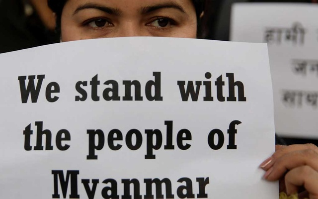 An activist affiliated with Civil Society holds a placard during a protest against Myanmar's military after seizing power from a democratically elected civilian government and arresting its leader Aung San Suu Kyi, in Kathmandu, Nepal February 1, 2021. REUTERS