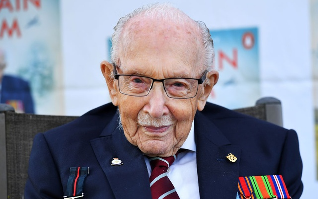 Captain Sir Tom Moore smiles as he launches his autobiography book 'Tomorrow will be a Good Day' at his home in Milton Keynes, Britain September 17, 2020. Reuters