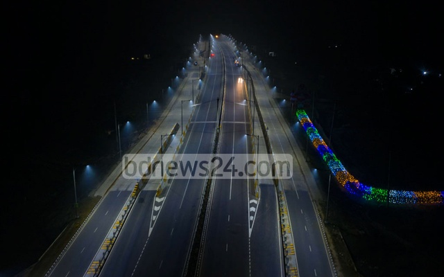 The Dhaka-Mawa Expressway pierces the darkness to connect with the twin bridges on the Dhaleshwari river.
