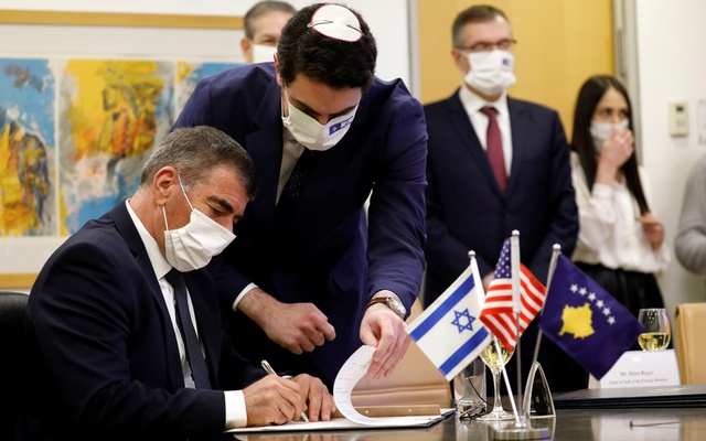 Israel's Foreign Minister Gabi Ashkenazi signs the agreement establishing diplomatic relations between Israel and Kosovo during a virtual ceremony with Kosovo's Foreign Minister Meliza Haradinaj Stublla, in the Israeli foreign ministry in Jerusalem February 1, 2021. REUTERS