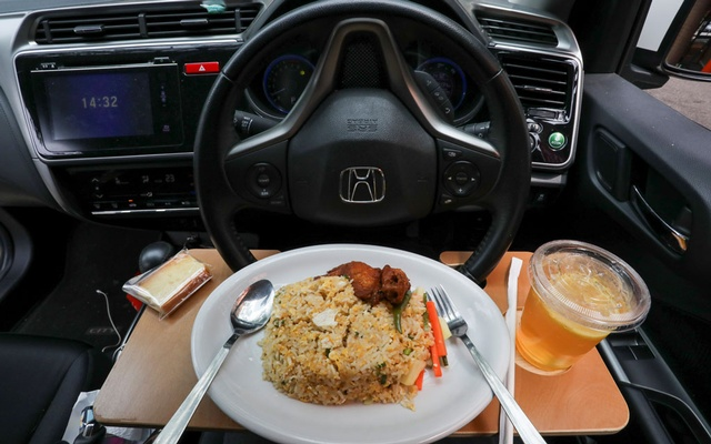 A dish for 'dine in car' service is pictured in a car, during a lockdown due to the coronavirus disease (COVID-19) outbreak, in Cyberjaya, Malaysia February 4, 2021. REUTERS
