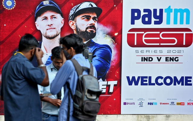 Members of media stand outside a stadium where India and England play their first Test cricket match, in Chennai, India, February 5, 2021. REUTERS