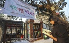 A reader checks out a book from a library founded by Boi Bondhu, an organisation of book-loving youths, next to Dhaka's Lalmatia New Colony ground in the month of the Language Movement. Photo: Asif Mahmud Ove