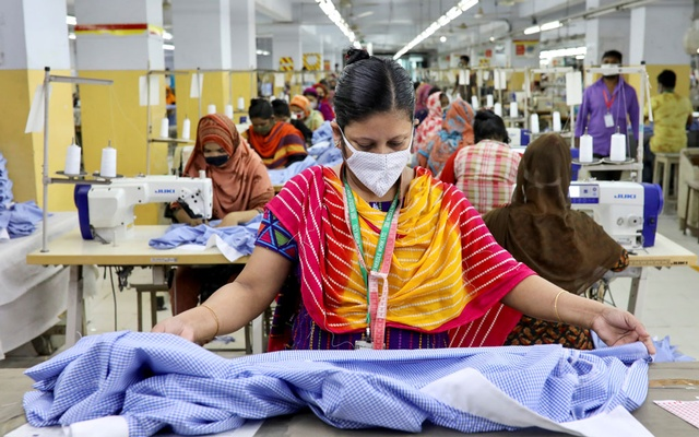 A woman works in a garment factory, as factories reopened after the government has eased the restrictions amid concerns over coronavirus disease (COVID-19) outbreak in Dhaka, Bangladesh, May 3, 2020. REUTERS/FILE Photo