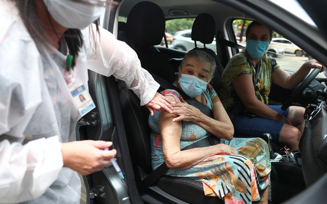 An elderly resident receives Sinovac's coronavirus disease (COVID-19) vaccine at a drive-thru centre for seniors citizens in Rio de Janeiro, Brazil, February 5, 2021. Reuters