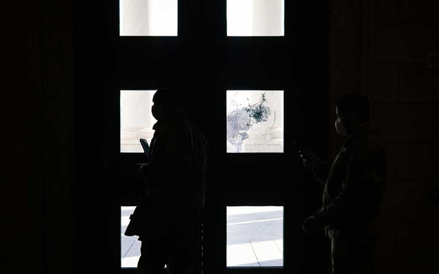 Damage from the mob attack remains visible on the doors of the Capitol in Washington before the start of the impeachment trial of former President Donald Trump on Tuesday, Feb 9, 2021