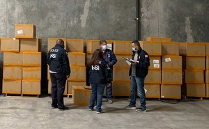 A photo provided by US Immigration and Customs Enforcement shows US Customs and Border Protection officers and El Paso members of Homeland Security Investigations in December 2020, during a seizure of counterfeit N95 surgical masks at a port cargo warehouse in El Paso, Texas. The New York Times