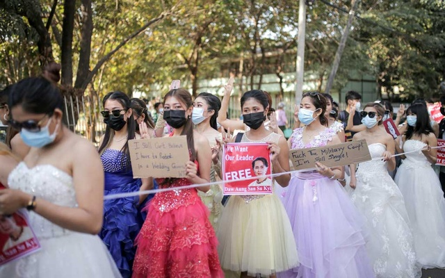 Women wearing ball gowns protest against the military coup and to demand the release of elected leader Aung San Suu Kyi in Yangon, Myanmar February 10, 2021