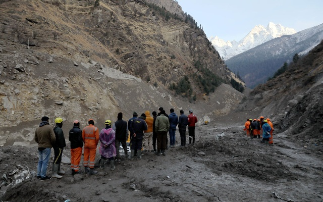 Members of rescue team work during a rescue and relief operation at the site of a destroyed hydroelectric power station after a flash flood swept down a mountain valley destroying dams and bridges, in Raini village in the northern state of Uttarakhand, India, February 10, 2021. REUTERS