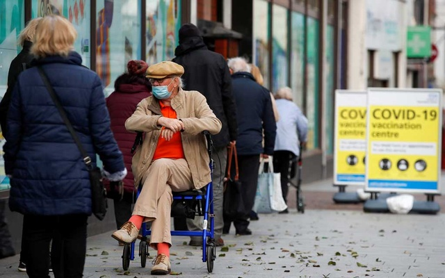 People queue to receive the coronavirus disease (COVID-19) vaccine outside a closed down Debenhams store that is being used as a vaccination centre in Folkestone, Kent, Britain Jan 28, 2021. REUTERS