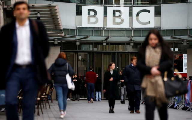 Pedestrians walk past a BBC logo at Broadcasting House in London, Britain January 29, 2020. Reuters