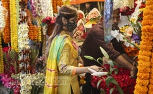 A young woman browses flowers at a shop in Shahbag ahead of Pahela Falgun and Valentine's Day. Photo: Asif Mahmud Ove