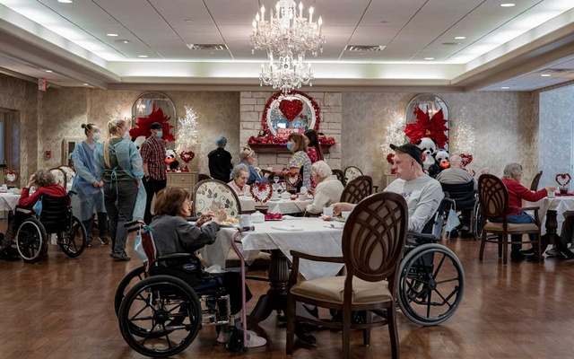 Residents eat lunch in the dining room of the Good Shepherd Nursing Home, which is decorated for Valentine's Day, in Wheeling, W Va, on Monday, Feb 8, 2021. Amr Alfiky/The New York Times