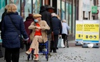 People queue to receive the coronavirus disease (COVID-19) vaccine outside a closed down Debenhams store that is being used as a vaccination centre in Folkestone, Kent, Britain January 28, 2021. REUTERS