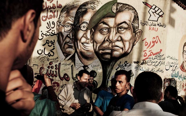 A mural in Cairo's Tahrir Square after Egypt's revolution depicts ousted President Hosni Mubarak and his former ministers, June 25, 2012. The New York Times
