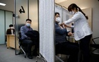 Participants take part in the coronavirus disease (COVID-19) vaccination mock drill at the COVID-19 vaccination centre in Seoul, South Korea, Feb 9, 2021. REUTERS
