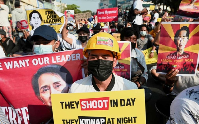 People participate in a protest against the military coup in Yangon, Myanmar, Feb 15, 2021. REUTERS