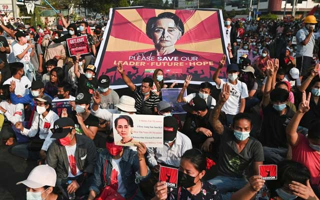 People participate in a protest against the military coup in Yangon, Myanmar, February 15, 2021. REUTERS/Stringer