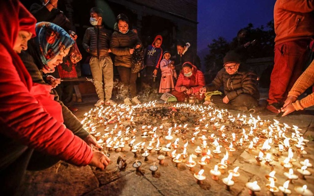 Devotees gather as they offer butter lamps during the Shreepanchami festival dedicated to goddess of education Saraswati in belief that the goddess will help devotees excel in education, in Kathmandu, Nepal Feb 16, 2021. REUTERS