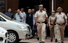 MJ Akbar, centre, leaving court in New Delhi in 2018. He filed a defamation lawsuit against a journalist after she accused him of sexual harassment. Credit...Anushree Fadnavis/Reuters