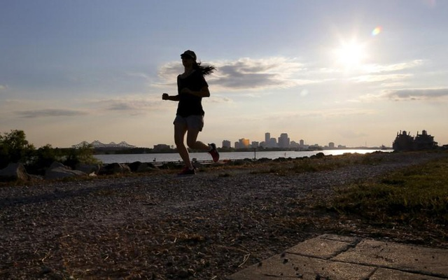 FILE PHOTO: A woman jogs along the levee in the Lower Ninth Ward neighbourhood one day before the ten year anniversary of Hurricane Katrina in New Orleans, Louisiana, August 28, 2015. REUTERS/Jonathan Bachman
