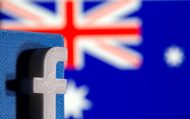 A 3D printed Facebook logo is seen in front of displayed Australia's flag in this illustration photo taken February 18, 2021. REUTERS