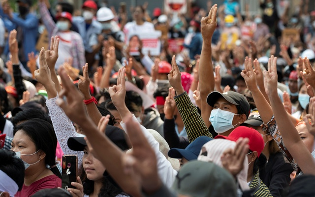 Demonstrators flash the three-finger salute during a protest against the military coup in Yangon, Myanmar, Feb 18, 2021. REUTERS