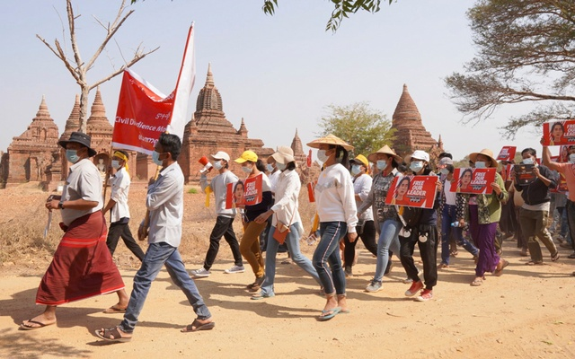 Demonstrators march during a protest against the military coup, near temples in Bagan, Myanmar February 18, 2021. REUTERS