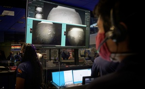 Members of NASA's Perseverance Mars rover team watch in mission control as the first images arrive moments after the spacecraft successfully touched down on Mars, at NASA's Jet Propulsion Laboratory in Pasadena, California, U.S. February 18, 2021. (NASA/Bill Ingalls/Handout via Reuters)