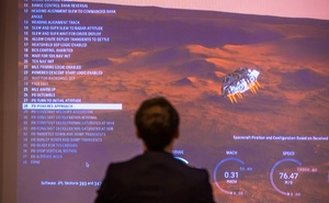French President Emmanuel Macron attends a viewing of the landing of the NASA Perseverance Mars rover on the planet Mars, at the French National Center for Space Studies (CNES) in Paris, France, February 18, 2021. Christophe Petit-Tesson/Pool via REUTERS