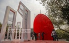 Artists replacing the red circle resembling the sun at the Central Shaheed Minar in Dhaka on Friday, Feb 19, 2021 as part of preparations for the observance of the Martyrs Day and International Mother Language Day. Photo: Mahmud Zaman Ovi