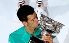 Tennis - Australian Open - Men's Singles Final - Melbourne Park, Melbourne, Australia, February 21, 2021 Serbia's Novak Djokovic celebrates with the trophy after winning his final match against Russia's Daniil Medvedev. Reuters