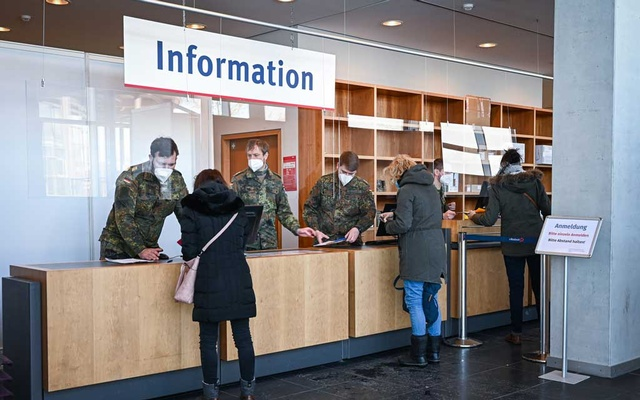 Soldiers register patients at the vaccination centre in Rostock, Germany on Feb. 12, 2021. (Lena Mucha/The New York Times)
