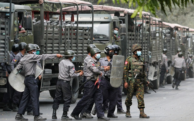 Police and soldiers are seen during a protest against the military coup, in Mandalay, Myanmar, February 20, 2021. Reuters