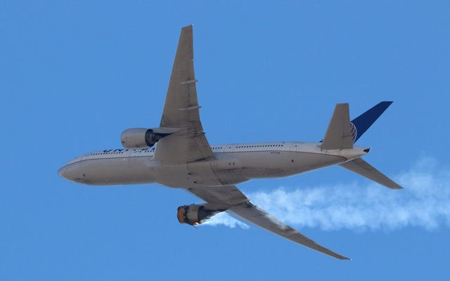 United Airlines flight UA328, carrying 231 passengers and 10 crew on board, returns to Denver International Airport with its starboard engine on fire after it called a Mayday alert, over Denver, Colorado, U.S. February 20, 2021. Hayden Smith/@speedbird5280/Handout via REUTERS