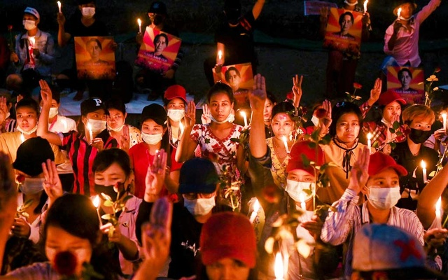 People gather during a candlelight vigil to protest against the military coup in Yangon, Myanmar, February 21, 2021. REUTERS