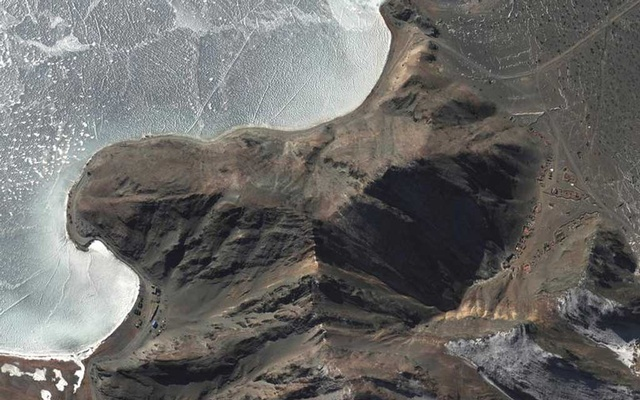 FILE PHOTO: Overview of deployments along areas known as Finger 7 and Finger 8, at Pangong Tso, in this handout satellite image provided by Maxar dated January 30, 2021. Satellite image (copyright) 2021 Maxar Technologies/Handout via REUTERS