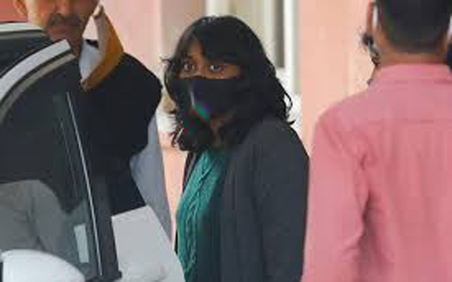 Disha Ravi, a 22-year-old climate activist, leaves after an investigation at National Cyber Forensic Lab, in New Delhi, India, February 23, 2021. REUTERS
