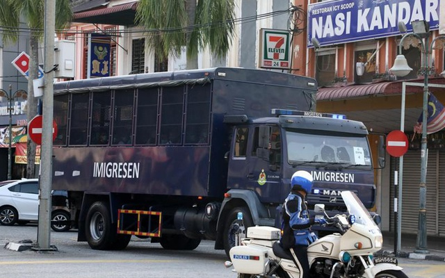 An immigration truck carrying Myanmar migrants to be deported from Malaysia is seen in Lumut, Malaysia February 23, 2021. REUTERS