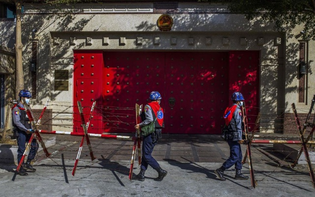 FILE -- Police place barricades in front of the Chinese Embassy in Yangon, Myanmar, as protesters march past on Friday, Feb. 12, 2021. Demonstrators have rallied at China's diplomatic missions, accusing Beijing of exporting the tools of authoritarianism to Myanmar. (The New York Times)
