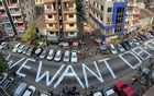 A slogan is written on a street as a protest after the coup in Yangon, Myanmar Feb 21, 2021. REUTERS