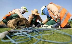 FILE PHOTO: Workers test soil as they grow grass for Qatar's 2022 World Cup, at an experimental facility in Doha, Qatar November 29, 2016. REUTERS