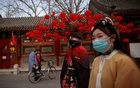 People wearing traditional hanfu dresses walk in Daguanyuan Park as China celebrates Lunar New Year of the Ox following an outbreak of the coronavirus disease (COVID-19) in Beijing, China, Feb 15, 2021. REUTERS/FILE