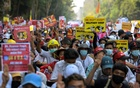 Demonstrators hold placards as they take part in a protest against the military coup in Yangon, Myanmar, February 22, 2021. REUTERS
